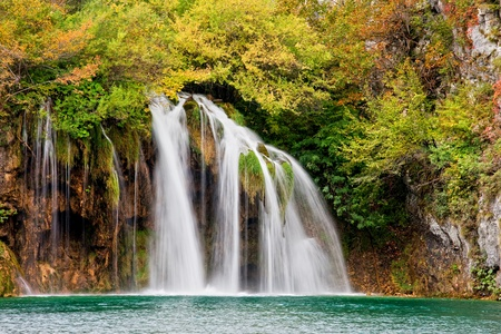 picturesque: Scenic waterfall in a picturesque autumn scenery of the Plitvice Lakes National Park in Croatia Stock Photo