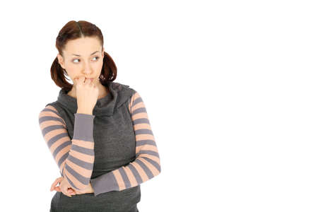 Young casual woman in thoughtful pose looking to the right side of the image isolated on white background photo