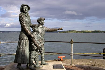 emigrant: COBH, IRELAND - JULY 1: Statue of an emigrant Annie Moore and her two brothers on July 1, 2007 in Cobh, Ireland.  The statue is placed outside Cobh Heritage Centre.