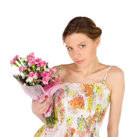 meaningful: Attractive young woman in dress holding bouquet of carnation flowers - isolated on white background Stock Photo