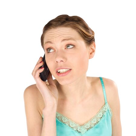 talkative: Casual young girl talking on the phone - isolated over white background