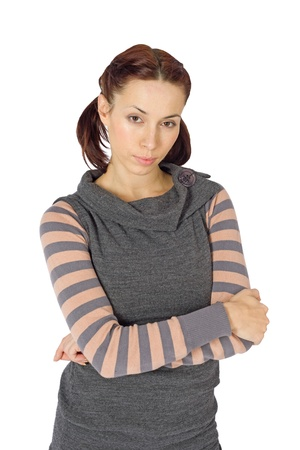 Young attractive casual woman with arms crossed isolated on white background photo