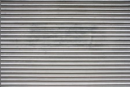 aluminium wallpaper: Steel garage door texture or background Stock Photo