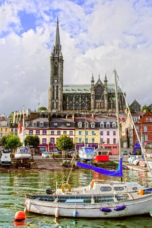 Cobh town and St. Colman's Neo-Gothic cathedral in Ireland, Cork County 写真素材