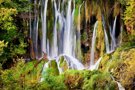 plitvice: Dream like waterfall in a beautiful autumn scenery of Plitvice Lakes National Park in Croatia Stock Photo