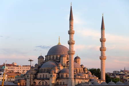 Sunset at the New Mosque (Turkish: Yeni Valide Camii) historic architecture in Istanbul, Turkey
