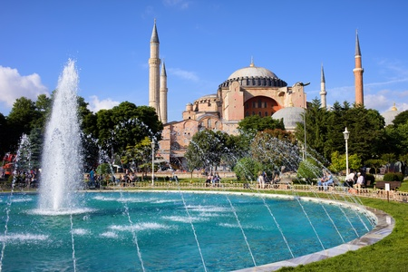 Byzantine architecture of the Hagia Sophia (The Church of the Holy Wisdom or Ayasofya in Turkish) and a park with fountain tranquil scenery in Istanbul, Turkey