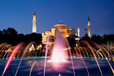 istanbul night: The Hagia Sophia Byzantine architecture and fountain illuminated at dusk, famous historic landmark and world wonder in Istanbul, Turkey