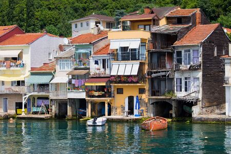 congested: Picturesque residential houses in tranquil scenery of Anadolu Kavagi village waterfront in Turkey at the end of the Bosporus Strait