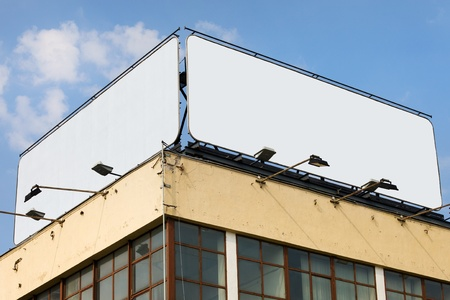 Two large blank billboards with copy space on a building roof Stock Photo