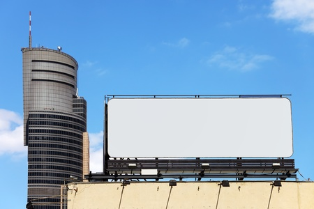 Large blank billboard on a building roof in the city downtown Stock Photo - 10844652