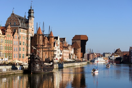 gdansk: Picturesque scenery in the Old Town of Gdansk (Danzig) in Poland with Motlava river and the Crane on the far end Editorial