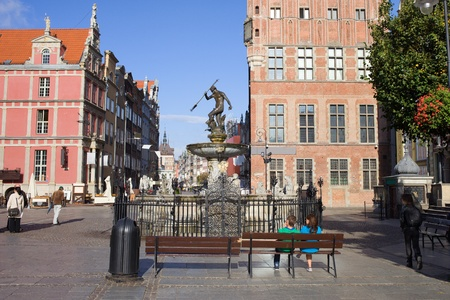 Old Town square with the Neptune Fountain in the city of Gdansk (Danzig), Poland photo