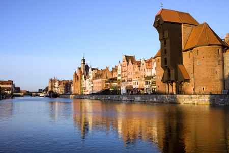 Gdansk (Danzig) Old Town waterfront along the river Motlawa in Poland at sunset, on the right side of the image The Crane (Polish: Zuraw) photo