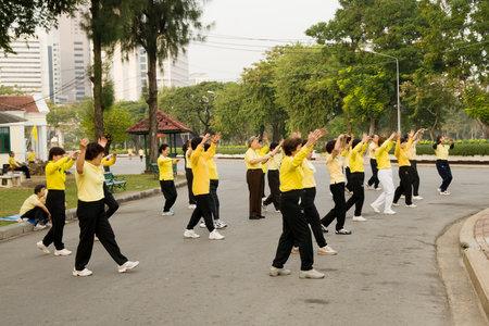 LUMPINI PARK, BANGKOK - DECEMBER 10: Group of people practising Tai Chi in the Lumpini Park in Bangkok, Thailand on December 10, 2007 Editorial