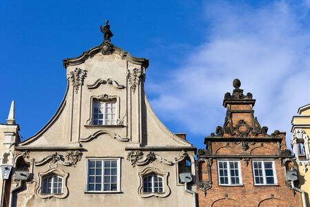 Ornate top of a tenement houses in the Old Town of Gdansk, Poland photo