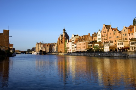 Early morning by the Motlawa river with scenic view on the Old Town of Gdansk in Poland