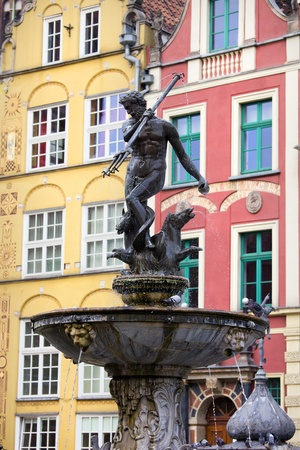 poseidon: Neptune Fountain (Poseidon in Greek mythology), bronze statue of the Roman God of the Sea in the Old Town of Gdansk, Poland Stock Photo