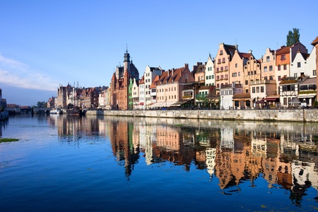 Scenic view with reflection on water of the Old Town of Gdansk in Poland by the Motlawa river