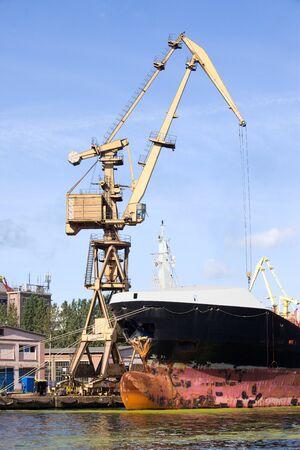 shiprepair: Large cargo ship repair in the shipyard of Gdansk, Poland