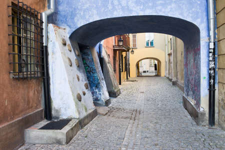 Cobblestone street with arched passage in the Old Town (Polish: Stare Miasto, Starowka) of Warsaw, Poland Stock Photo - 11305171