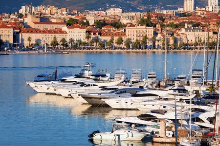 mediterranean house: Split cityscape on the Adriatic Sea in Croatia, Dalmatia region, luxury motorboat harbour in the foreground