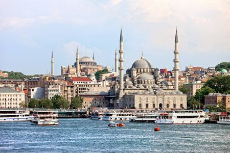 farther: Scenery of the Eminonu district in the city of Istanbul in Turkey with New Mosque and Hagia Sophia at the farther end Stock Photo