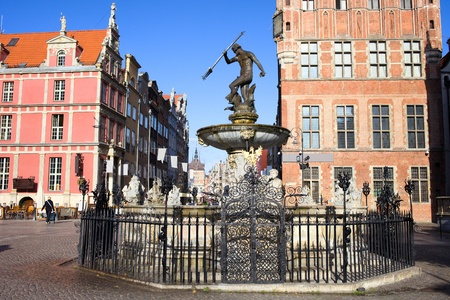 neptun: Neptune Fountain with bronze statue of the Roman God of the sea at the Old Town square in Gdansk, Poland Stock Photo