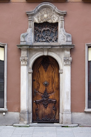 richly: Richly decorated antique door on a historic apartment house in the Old Town of Gdansk, Poland