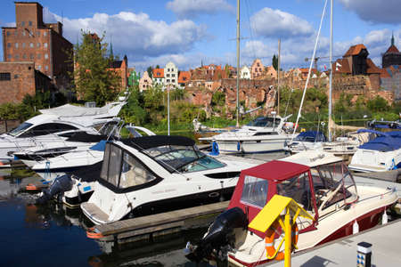 motorboats: Motorboats and sailboats at the marina in the city of Gdansk in Poland Stock Photo