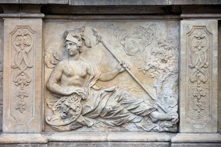 bas: 18th century bas-relief of the Goddess Athena in Greek mythology by Johann Heinrich Meissner on the historic tenement house terrace in the Old Town of Gdansk, Poland