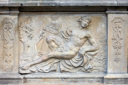 18th century bas-relief of the Apollo  God in Greek mythology  by Johann Heinrich Meissner on the historic tenement house terrace in the Old Town of Gdansk, Poland photo