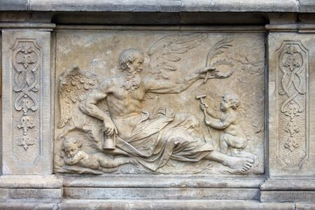 18th century bas-relief of the Chronos  God in Greek mythology, personification of Time  by Johann Heinrich Meissner on the historic tenement house terrace in the Old Town of Gdansk, Poland photo