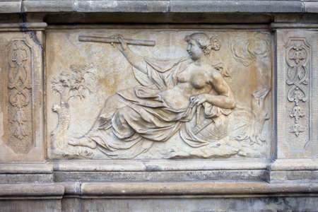 speculate: 18th century bas-relief, allegory of Science by Johann Heinrich Meissner on the historic tenement house terrace in the Old Town of Gdansk, Poland