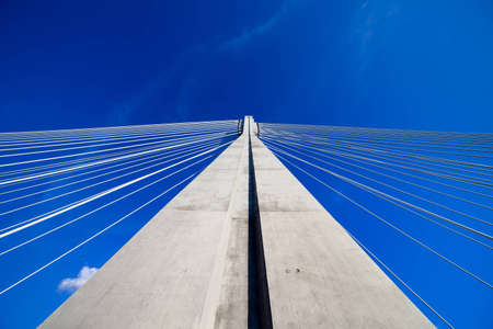Abstract modern architecture of the Swietokrzyski suspension bridge pylon in Warsaw, Poland photo