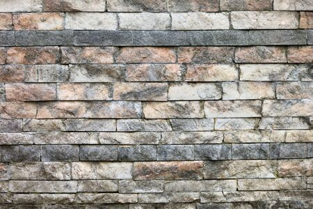 untreated: Wall texture made from rough untreated marble bricks of different sizes