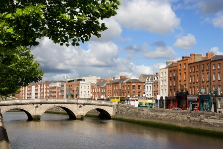 Scenic city of Dublin with an old Mellows Bridge (Queen Maeve Bridge) on the river Liffey in Ireland