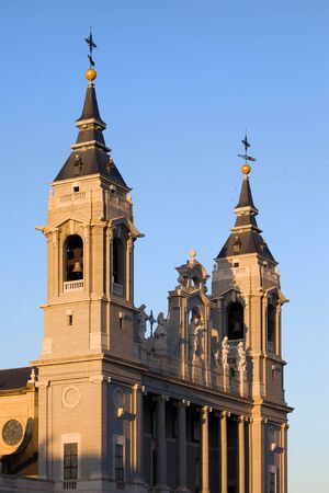 sights: Almudena Cathedral (Cathedral of Saint Mary the Royal of La Almudena) bell towers in Madrid, Spain Stock Photo