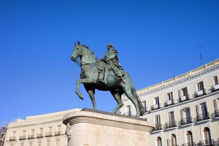 socle: Equestrian statue of King Charles III, historic landmark on Puerta del Sol in Madrid, Spain