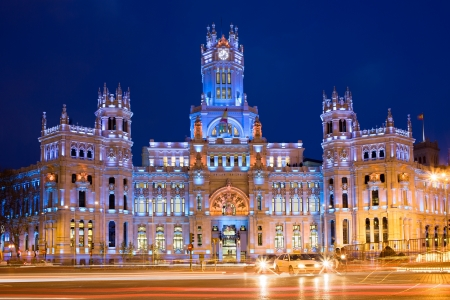 Palacio de Comunicaciones at Plaza de Cibeles illuminated at night in the city of Madrid, Spain