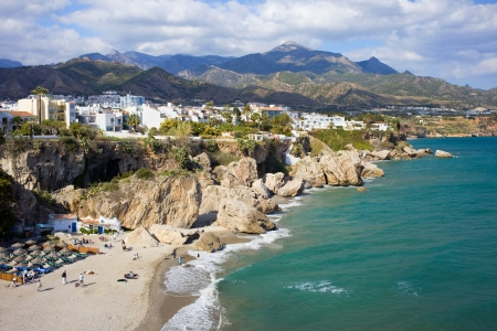 Scenic resort town of Nerja with small sandy beach on Costa del Sol by the Mediterranean Sea in Spain, southern Andalusia region, Malaga province. photo