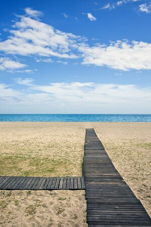Wooden path to the sandy beach on Costa del Sol in Spain between Marbella and Puerto Banus. Stock Photo - 13713315
