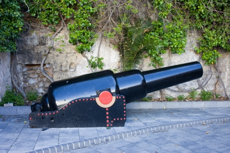 gunnery: Old naval cannon on a sidewalk in Gibraltar. Stock Photo