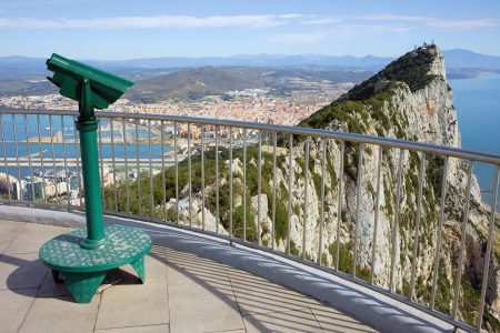 gibraltar: Gibraltar rock vantage point on southern Iberian Peninsula, La Linea city in Spain at the far end. Stock Photo