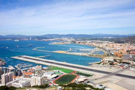 cadiz: Gibraltar airport runway and La Linea de la Concepcion in Spain, southern Andalucia region, Cadiz province.