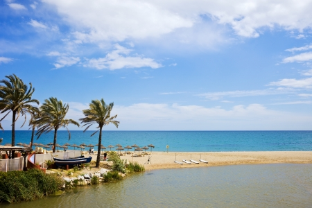 Summer vacation beach and sea scenery on Costa del Sol in Spain, located between Marbella and Puerto Banus, waters of Green River (Spanish: Rio Verde) and Mediterranean Sea. photo
