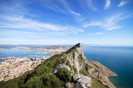 Gibraltar Rock view from above, on the left Gibraltar town and bay, La Linea town in Spain at the far end, Mediterranean Sea on the right. photo