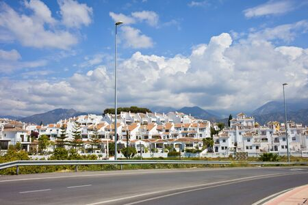 White village of Punta Lara next to the Calle Goya street on Costa del Sol, near resort town of Nerja in southern Andalucia, Malaga province, Spain.