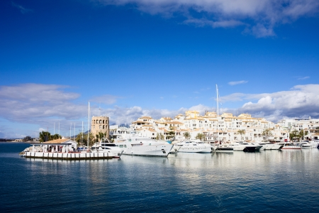 Luxurious yachts in the marina of resort town Puerto Banus on Costa del Sol, southern Andalucia, Spain.