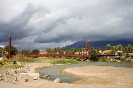 Bridge on the Green River (Spanish: Rio Verde) between resorts towns of Marbella and Puerto Banus, Costa del Sol, Andalucia region, Malaga province, Spain. photo